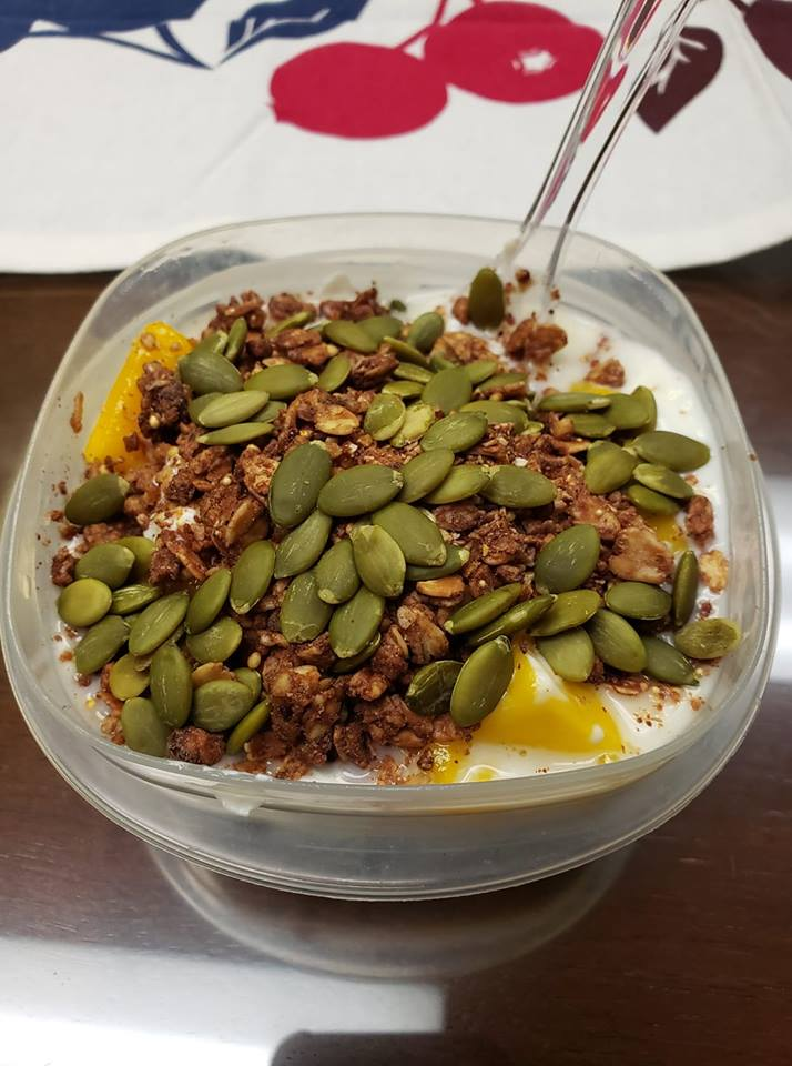 high protein breakfast with greek yogurt, pumpkin seeds, protein granola and mango
